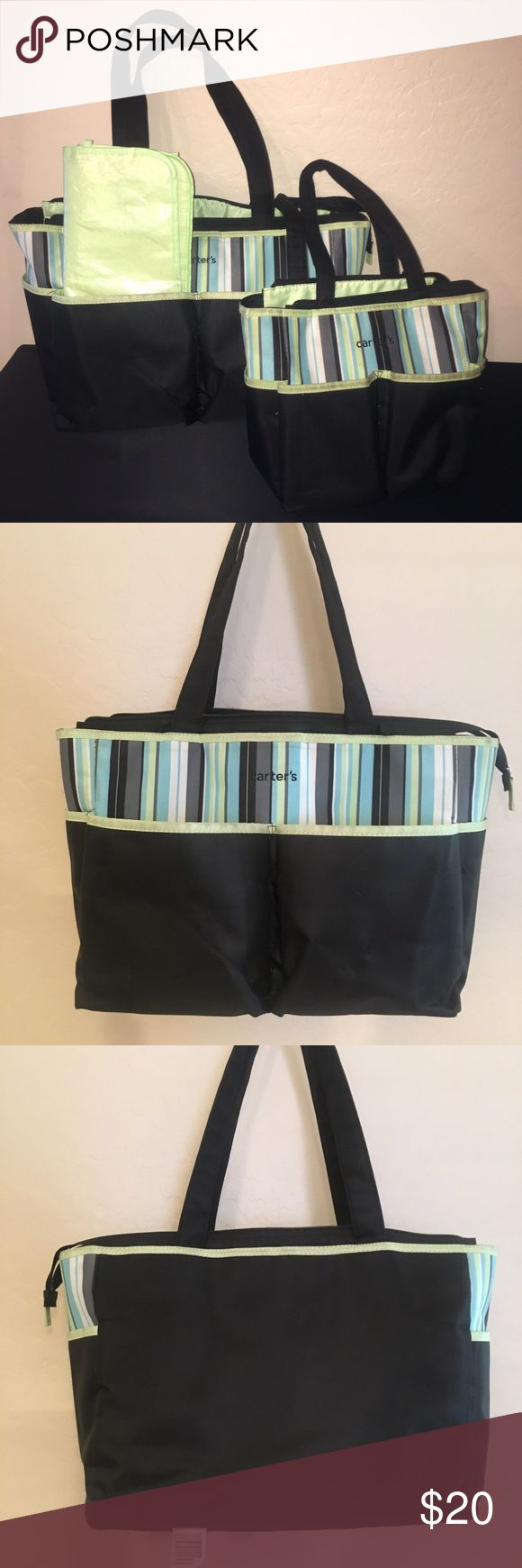 Carter's Diaper Bag Set Lime green, baby blue, white, grey, and black striped bag, with black bottom and lime green interior. 2 pockets in front and side. Changing pad. Large bag has small clear bag insert. Some pen ink stains on interior sections of each bag. Bags are in really good condition. The large bag is like new. I used the small one a lot more than the larger one.  Large bag 19 x 11 x 6.75 inches Small bag 12 x 9 x 4.5 inches Carter's Bags Baby Bags