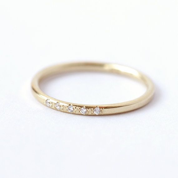 Dainty diamond ring with five 1 mm diamonds in 18k soild gold.  Super comfortable sparkly wedding ring.  Makes a lovely stack with all of our thin