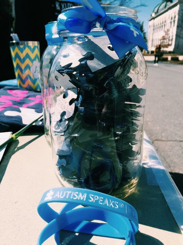 """""""Xi Guessed It!"""" - a game that can be played while tabling for Autism Awareness Month. Whoever guesses the number of puzzle pieces in the jar, or who is closest, wins Autism Speaks swag."""
