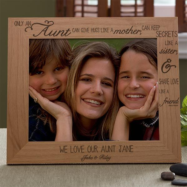 """Sweet photo frame for your aunt is inscribed, """"Only an Aunt can give hugs like a Mother, keep secrets like a Sister & share love like a Friend"""".  Personalize with any 2 lines underneath the picture."""