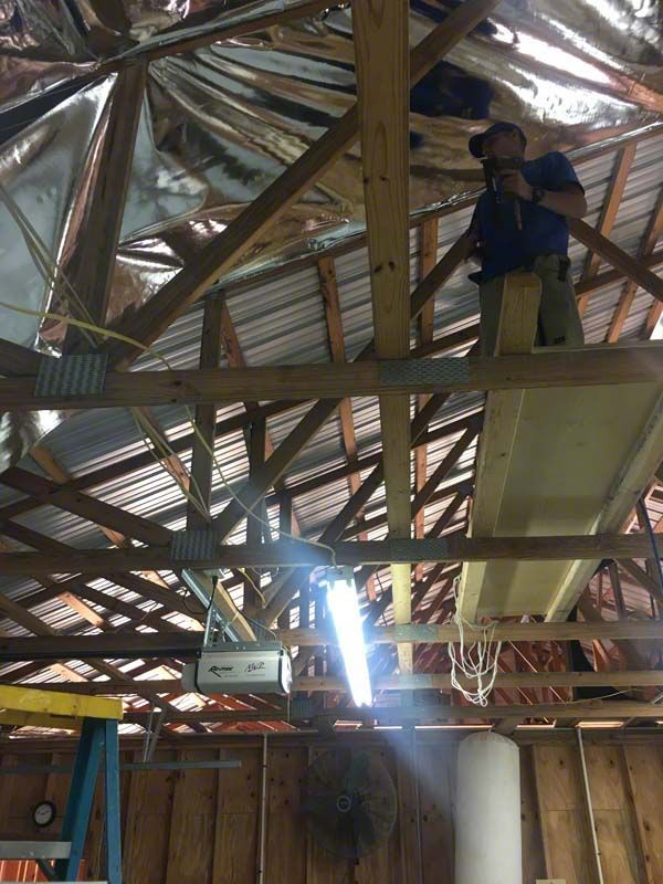 Is that guy insulating the roof of a huge metal building by himself? Why, yes, he is. That's just how easy it is to work with the InfraStop® line of reflective foil insulation products. http://www.insulationstop.com/metal-building-insulation