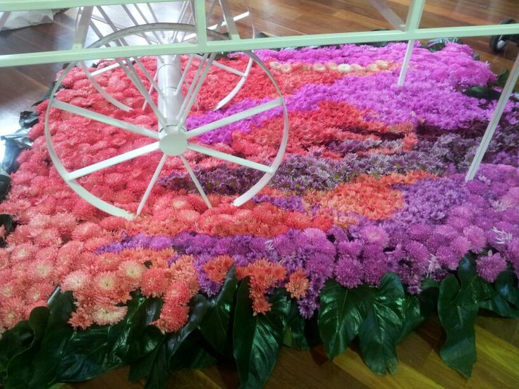 Wagon sitting on a floral carpet
