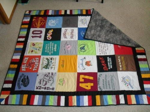 T-shirt quilt.  Cut 12 x 12 blocks from the shirt and use pieces from the rest of the shirt for the border.