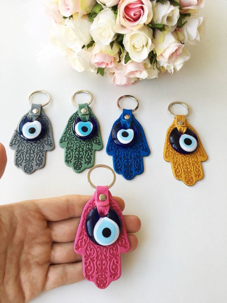 A personal favourite from my Etsy shop https://www.etsy.com/listing/475651053/hamsa-evil-eye-keychain-greek-nazar-bead Hamsa evil eye keychain - greek nazar bead - lucky evil eye keychain - Bag Charm Keyring - Protection Yoga Accessories - Turkish evil eye It is very beautiful keychain or bag charm. Hamsa evil eye keychain/ bag charm is available in several different color: -grey -green -pink -dark blue -yellow It believes that evil eye hamsa bring happiness and luck!