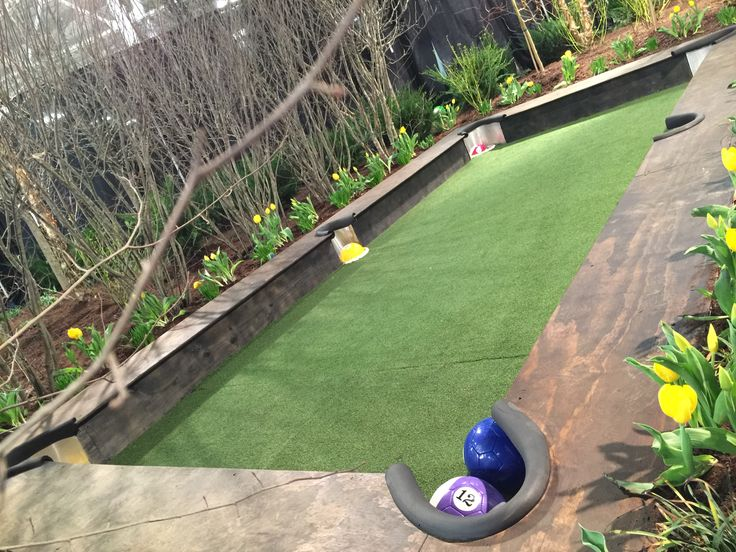 Yard billiards / pool table made with soccer balls, sunken buckets, and turf