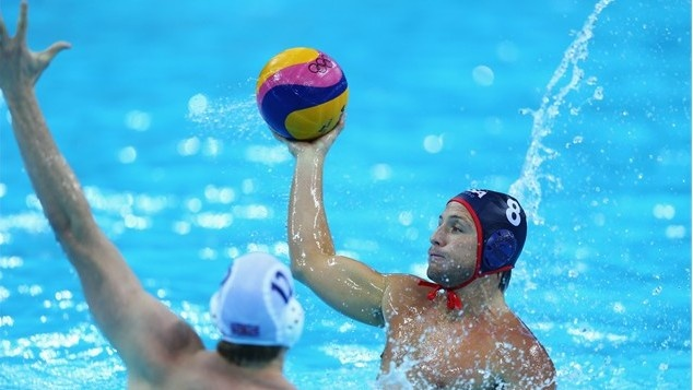 Captain Tony Azevedo scored four goals — three of them in the opening quarter — and the U.S. men's water polo team beat Britain 13-7 to remain undefeated at the London Olympics.