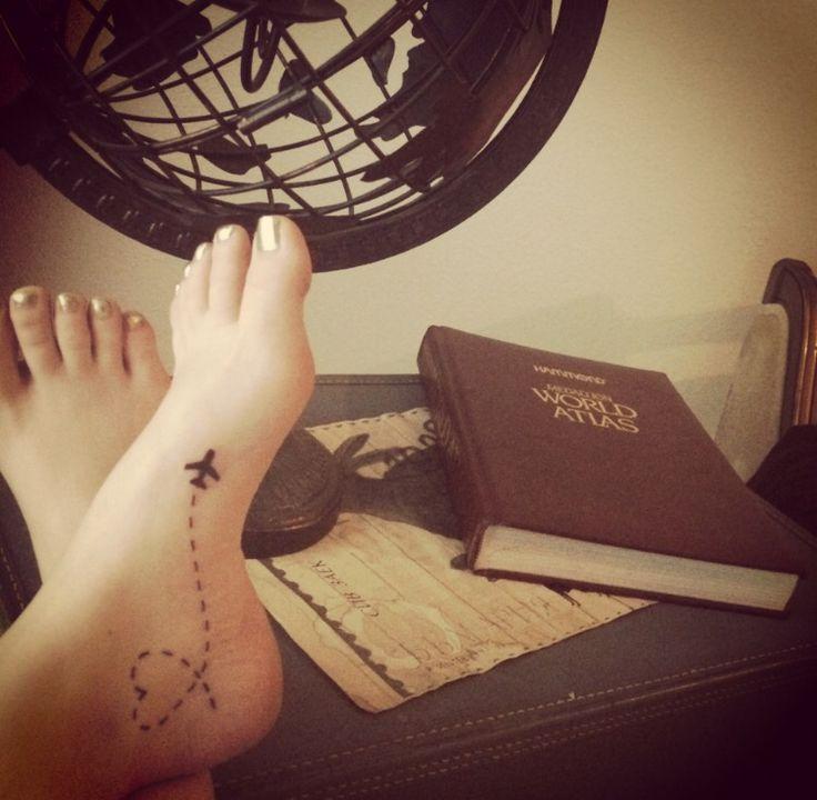Love travel foot tattoo