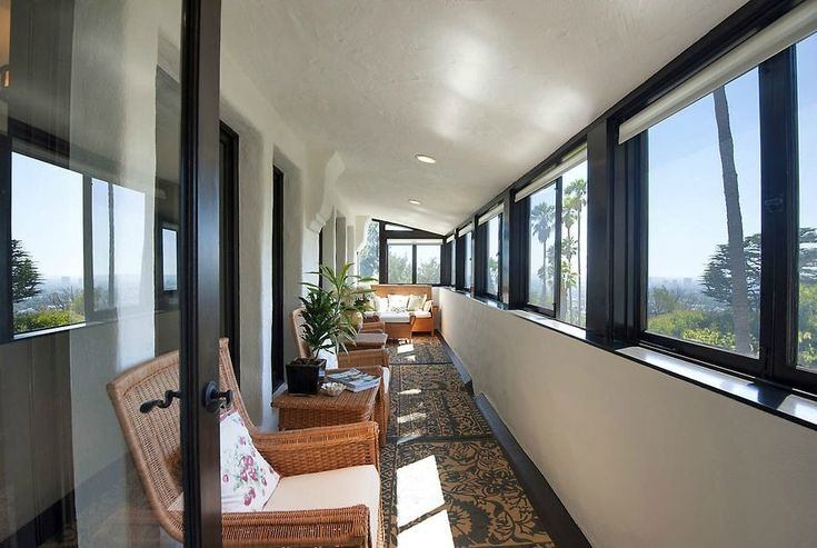 An enclosed patio offers panoramic views.