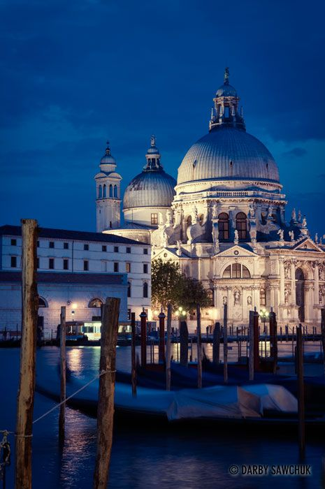The Church of Santa Maria della Salute from across the Grand Canal at night in Venice.