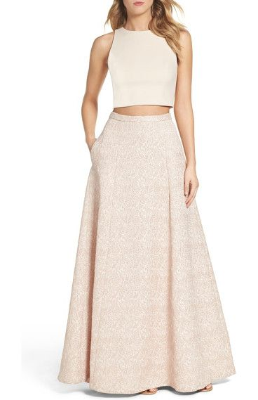 two-piece gown by Aidan by Aidan Mattox. A pop of midriff gives just-right edge to this soft, pastel gown full of metallic texture through the A-line skirt.