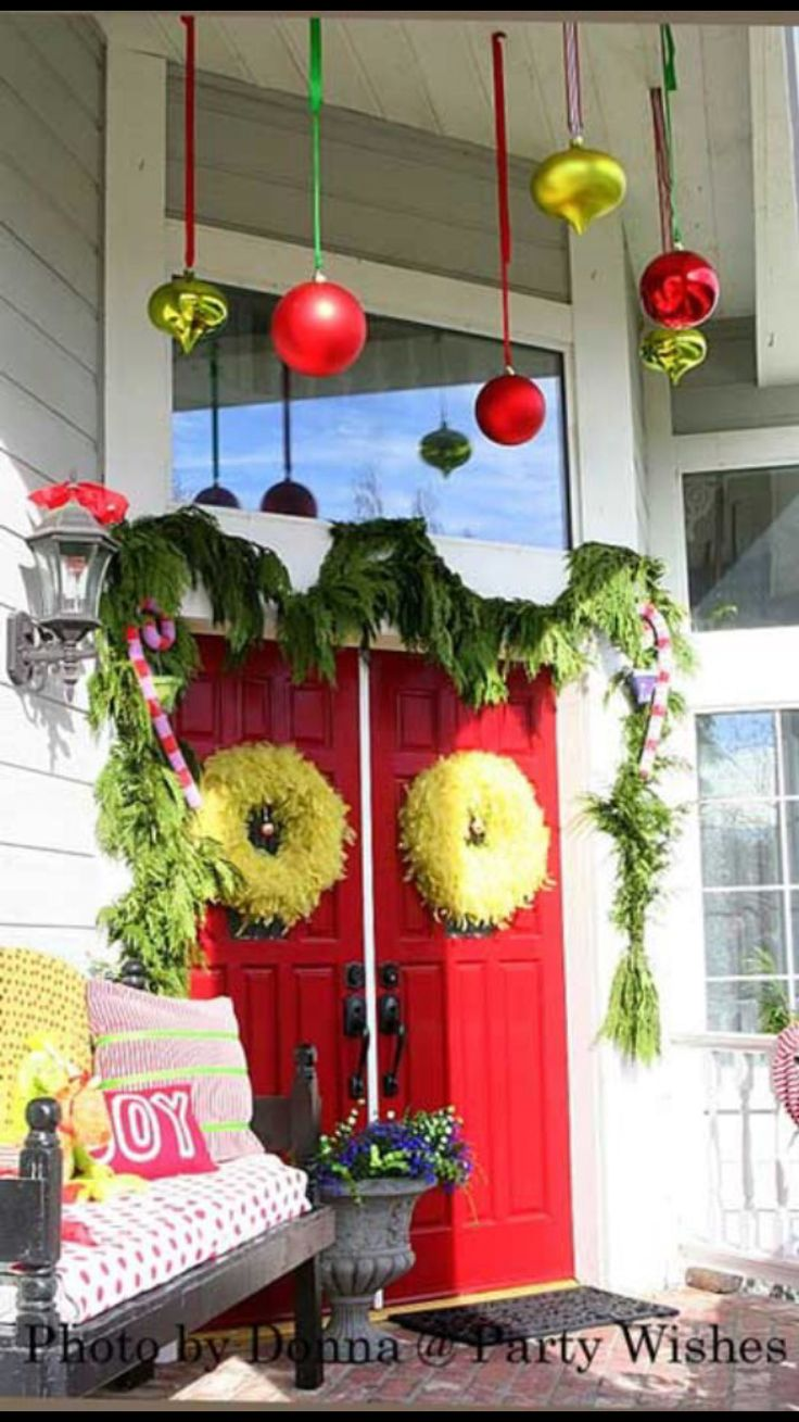 Love the ornaments hanging from porch ceiling.A Whole Bunch Of Christmas  Porch Decorating Ideas - Christmas Decorating -