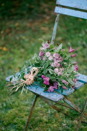Natural posy of garden flowers, including astrantia and herbaceous clematis