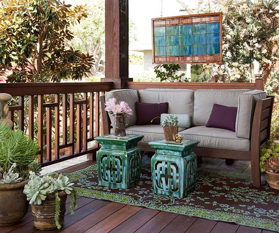 Exotic Escape. A mix of wooden accents and colorful potted plants give this porch an exotic treatment you'd expect to find in a paradise retreat. Ceramic garden stools stand in as an all-weather alternative to an ottoman or cocktail table.