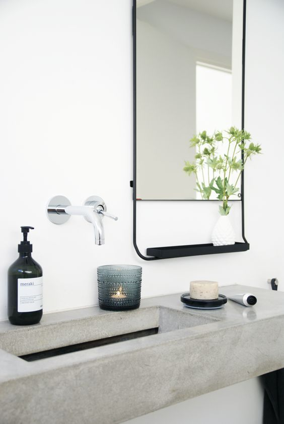 Cement sink in a white bathroom. Love the mirror and the metal tray attached to it. Possibilities of display!!!