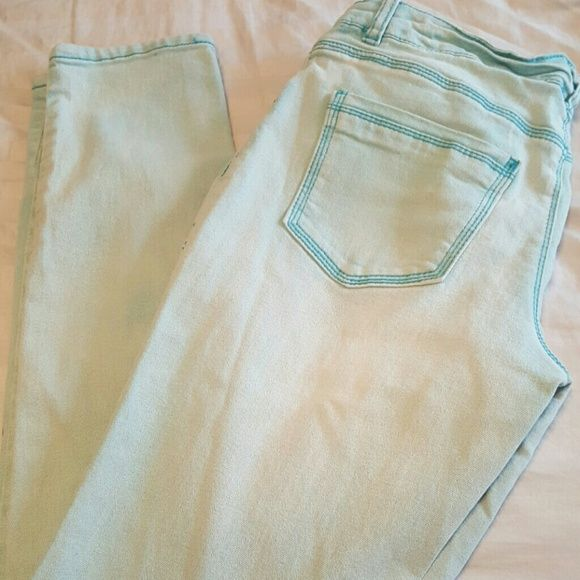 NEW Mossimo Blue skinnies Distressed like light blue skinny jeans. Front and back pockets. Inseam 30in Mossimo Supply Co Jeans Skinny
