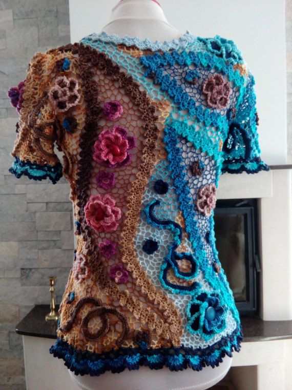 Crochet top/blouse made in Irish crochet technique. It is an elegant summer top that can be worn in any occasion with pants or with a skirt. Size S, M  It is a stretchable top. Maximum bust 90 cm - 35,43 inch Maximum waist 82 cm - 33,07 inch Max hips 102 cm - 40,15 inch  Length of the top 62 cm - 34,64 inch The item is ready to be shipped.  The product was made in a smoke and pet free home.  This handmade item should be hand washed in moderately warm water and laid flat to dry.  The ord...