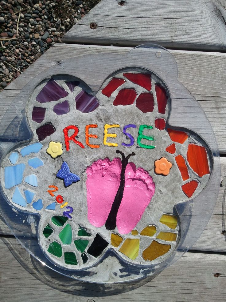 butterfly footprint stepping stone. weather proof by using outdoor clear gloss spray paint.