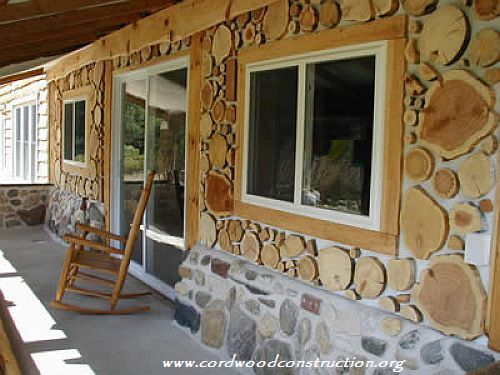 Tom Huber cordwood siding with stone with logo