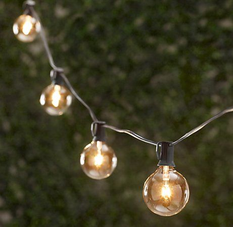 "I like these globe or ""carnival"" lights, but would make my own from some socketed strand:    http://www.moderndisplay.com/Online-Shopping/Light-Wiring/Cord-C-9-White-6-Spacing-Per-Socket.html    and bulbs:     http://www.partylights.com/Commercial/G40-Bulbs_2    It works out to $1.20 per bulb. Or $2.40 a foot, you've just got to screw the bulbs in, and wire the plugs."