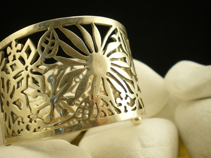 "A striking bracelet, part of the fashionable ""Spring"" series designed by Marialena Leondaraki. The bracelet is of a substantial size that is guaranteed to impress and features in its design an abstract bouquet of flowers, leafs and stems.         It is handcrafted from solid sterling silver and has a beautiful polished finish. http://eternal-elegance.com/index.php?page=shop.product_details&flypage=flypage.tpl&product_id=139&category_id=19&option=com_virtuemart&Itemid=216&lang=en"