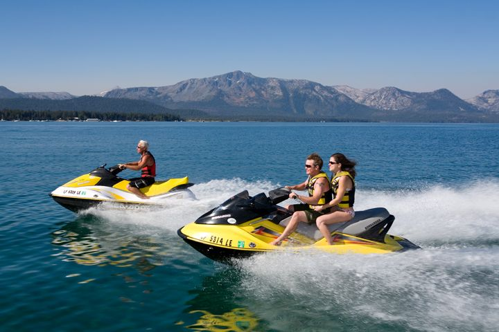Jet skiing in Lake Tahoe. Rent your favorite water equipment at Camp Richardson Marina in South Lake Tahoe, CA, including jet skis, kayaks, SUPs, power boats. www.CampRichardson.com