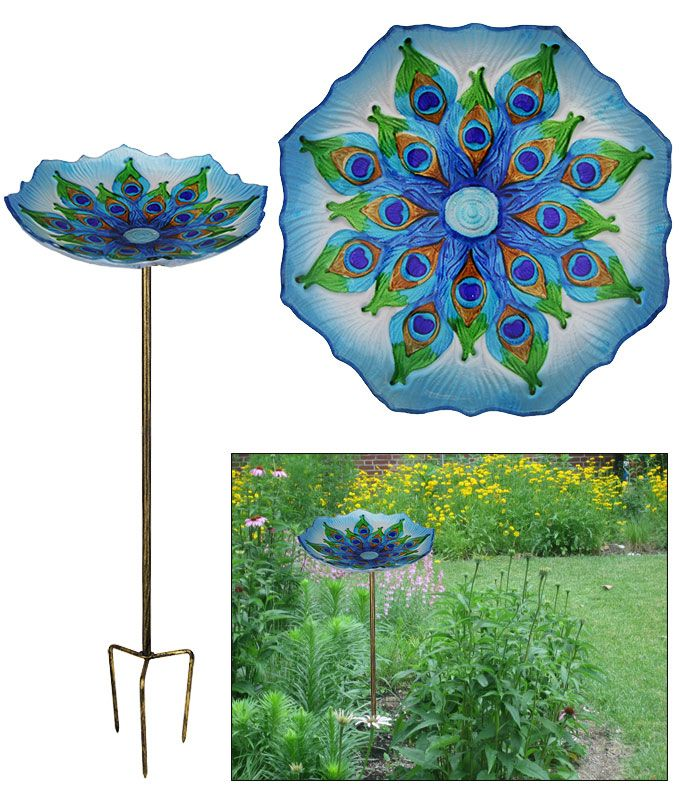 """Peacock Glass Bird Bath at The Hunger Site. Grace your garden with stately peacock panache while providing a colorful place for birds to frolic. Or fill with seed for a dazzling bird buffet. Our glass bird bath compacts neatly for easy storage in the winter months. Glass & metal. 24"""" H x 11"""" diameter (61 x 27.9 cm) Imported"""