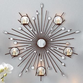 """Stellar display for any wall! Mirror glass and acrylic details on rays reflect the beauty of candlelight. Includes five glass votive cups. Hanging hardware not included. 24¾""""dia. www.partylite.biz/tenatilk"""