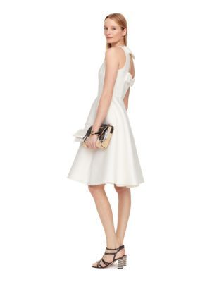 need a new dress? this one, which features an open back framed by elegant bows, is equal parts simple and stunning, perfect for drinks, dinner, dancing and more.
