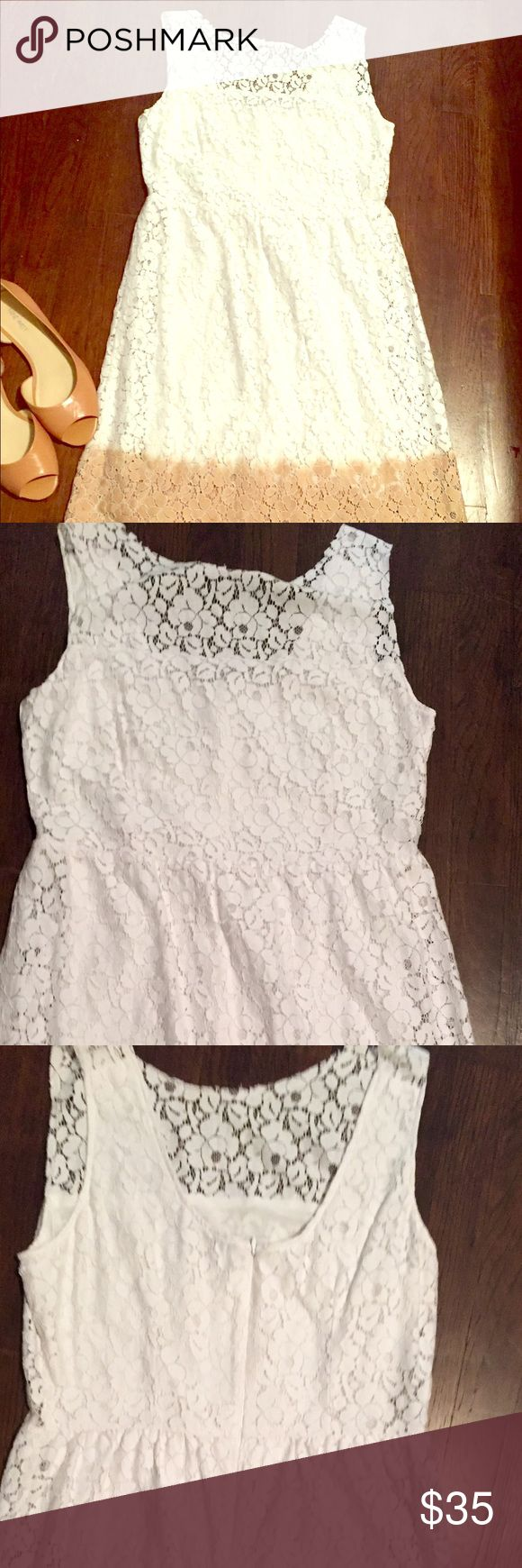 Beautiful white and tan lace dress! Very light weight and soft lace dress. Lace illusion top. White with tan on the bottom. Can be dressed up or down. Only worn once! Velvet Dresses Midi