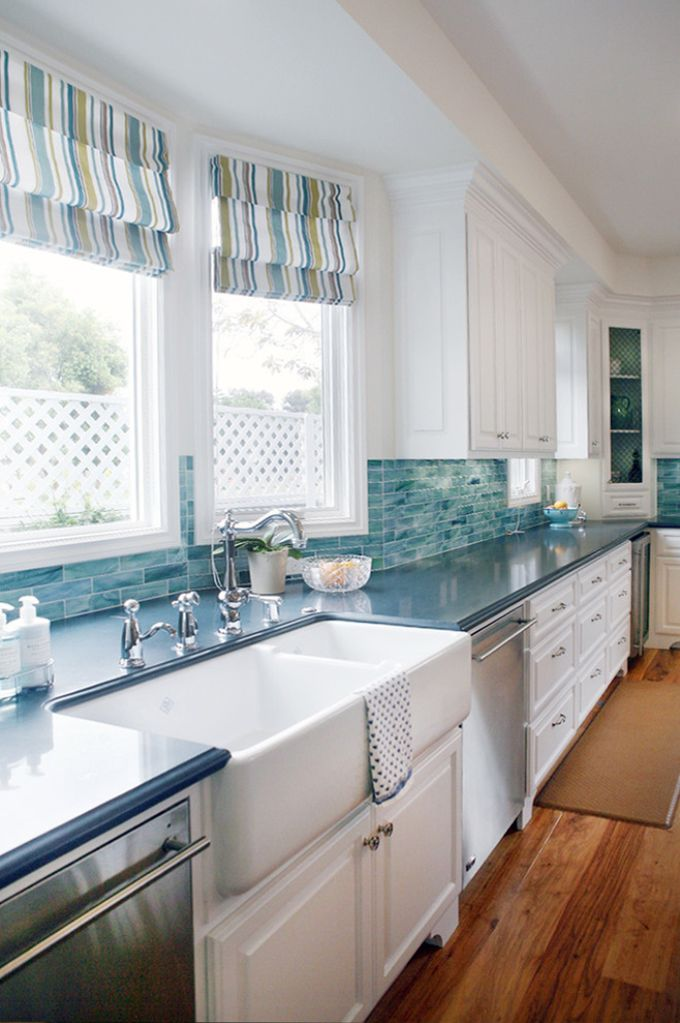 The back splash tile of this kitchen design add interest and create the coastal vibe.