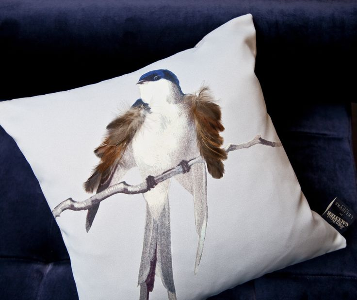 Jean Paul Gaultier blue bird cushion embellished with real feathers, available at our urban living interiors showroom in London
