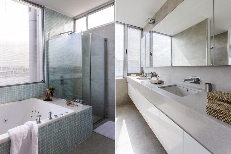Una casa con mirada moderna En el baño, la mesada de Silestone gris claro con mueble suspendido de frente blanco (Cato). Junto al ventanal, el revestimiento de venecitas y la división de la ducha conceden un clima etéreo. / Daniel Karp