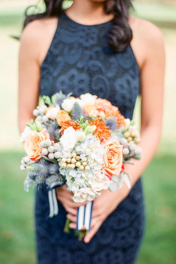 Orange and blue autumn #bouquet Photography: Brklyn View Photography - www.brklynview.com  Read More: http://www.stylemepretty.com/2014/06/24/autumn-barn-wedding-in-the-hamptons/