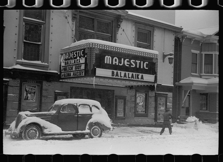 shoveling snow away from Majestic Movie Theater in Chillicothe OH Feb 1940