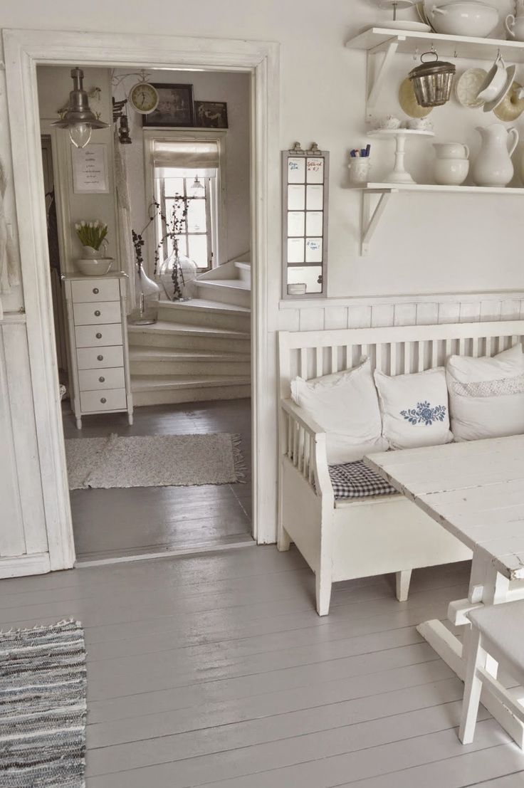 Love the little bench with the pillows and spindle back - much more comfy. Also like the window over the curving staircase. Shabby Chic