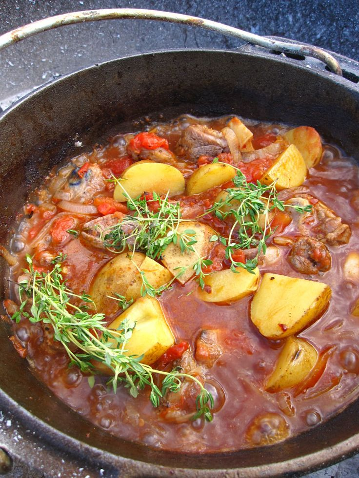 "Potjiekos (""Food in a pot"") - This dish is traditionally cooked over a fire in a three legged cast iron pot.  It originated with the Voortrekkers (pioneers) who travelled into the unknown interior of Southern Africa in the18th Century,  in wagons pulled by oxen. Potjiekos is one of the most popular dishes in SA today"