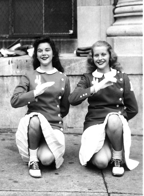 """""""Two cheerleaders of Emerson High School, Union City, NJ the one  on the right being Pat Willis, taken by Chester on Saturday afternoon  Oct 26th, 1946 in front of Emerson High School on 18th St. between New  York and Palisades Aves., Union City, NJ"""""""