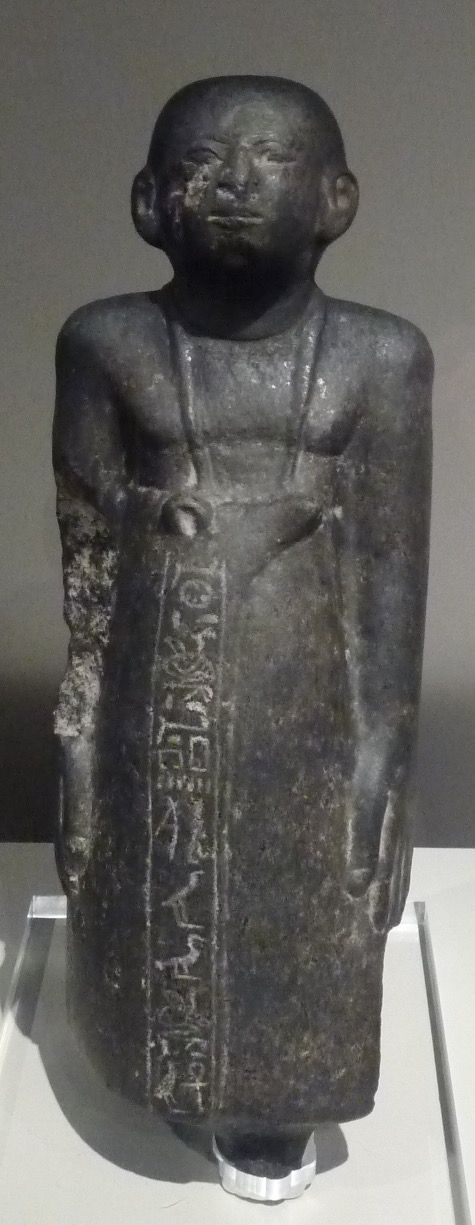 Statuette of the ancient Egyptian vizier Iymeru, son of vizier Ankhu. He was in charge under pharaohs Khendjer, Imyremeshaw and beyond. The head is not the original one and stylistically belongs to the New Kingdom; perhaps was put on the statue during the 19th century. Granodiorite, unknown provenance, 13th Dynasty, Middle Kingdom. Turin, Museo Egizio