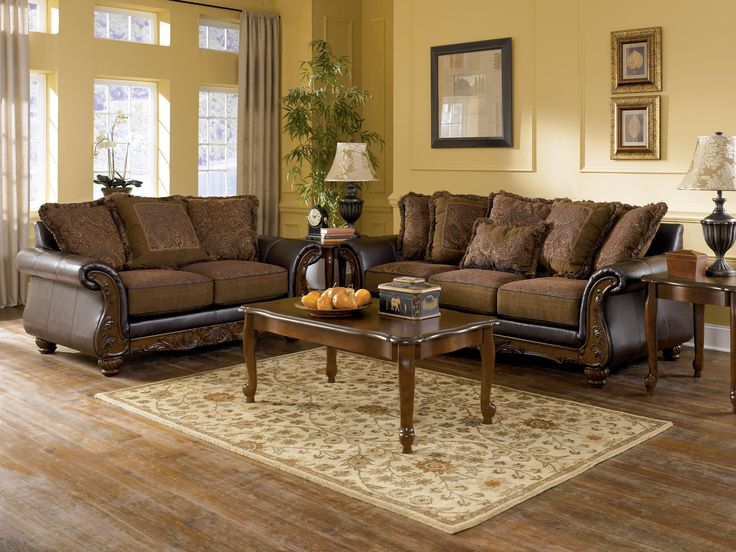 Wilmington Walnut Traditional Exposed Wood Sofa With Loose Pillow Back By Signature Design By