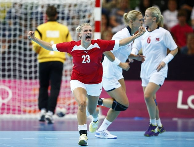 Denmark's Ann Grete Norgaard celebrates a goal against Norway in their women's handball Preliminaries Group B match at the Copper Box venue during the London 2012 Olympic Games August 3, 2012. REUTERS/Marko Djurica