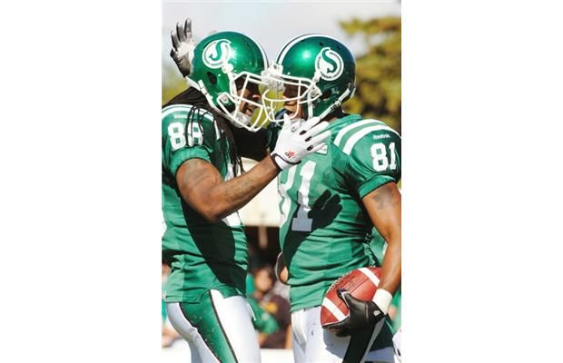 Saskatchewan Roughriders wide receiver Taj Smith (#88) congratulates teammate Saskatchewan Roughriders slotback Geroy Simon (#81) on his touchdown on Sunday. The veteran Saskatchewan Roughriders slotback had five receptions for 44 yards and two touchdowns in their 48-25 victory.
