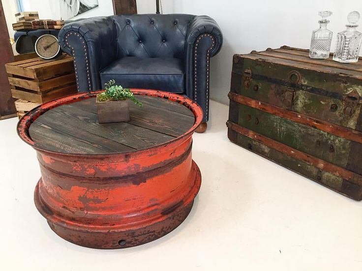 We turned this old tractor rim into a one of a kind coffee table.