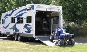 Toy haulers are cool. You can find amazing deals on toy haulers by vising local RV auctions near you :)