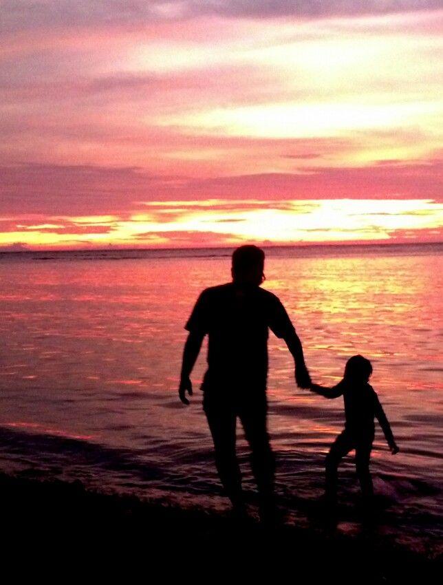 dad & son on sunset at pulau melinjo