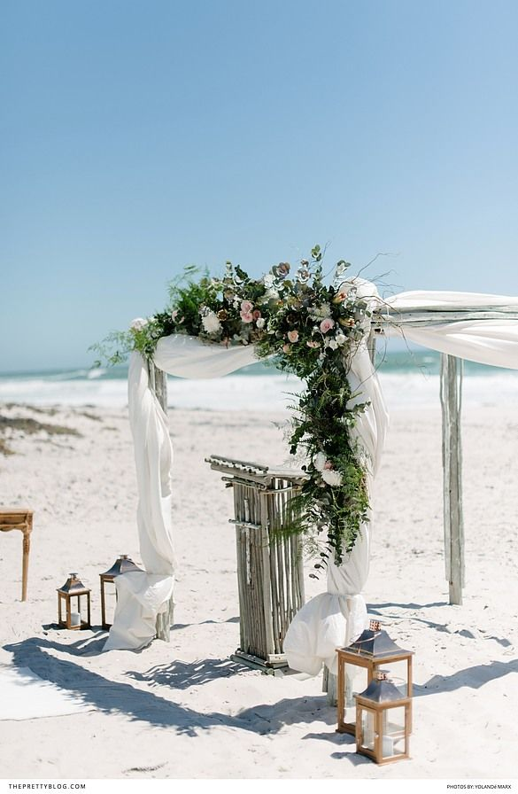 The bride's mermaid-style lace dress was the perfect choice for their romantic day at the beach!