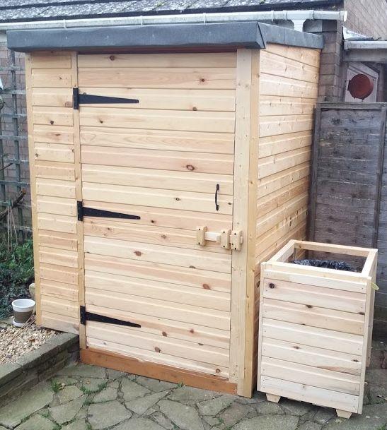 My new DIY Shiplap Shed with matching garden bin.