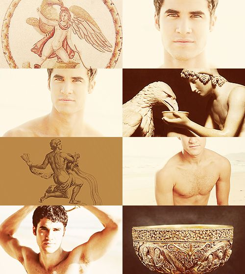 """Darren Criss as Ganymede, a divine hero whose homeland was Troy. He was the son of Tros of Dardania, from whose name """"Troy"""" was supposed to derive, and of Callirrhoe. His brothers were Ilus and Assaracus. In one version of the myth, he is abducted by Zeus, in the form of an eagle, to serve as cup-bearer in Olympus. Homer describes Ganymede as the most beautiful of mortals..."""