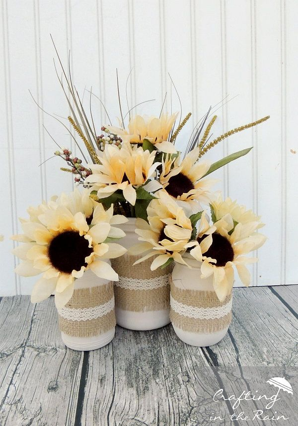 Use burlap and lace trim to decorate the outside of your Mason jars, then fill with sunflowers, grass, and wheat—all of which you should be able to find at your local dollar store.