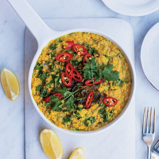 Red Lentil Dal with Coconut Milk and Kale | Bloggers Melissa and Jasmine Hemsley serve these creamy, superflavorful lentils with vibrant toppings: spice-cooked onions, red chiles and chopped cilantro.