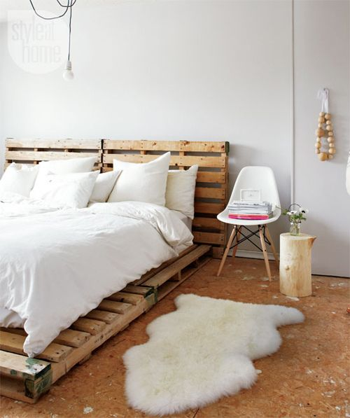 Lay enough pallets, add king/2 twin box springs and the king mattress and you've got an awesome DIY bed and headboard.  diy: making furniture from pallets by the style files, via Flickr